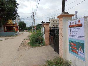 Janandolan Campaign On COVID 19 - IEC poster sticking at Rallaguda of Shamshabad mandal