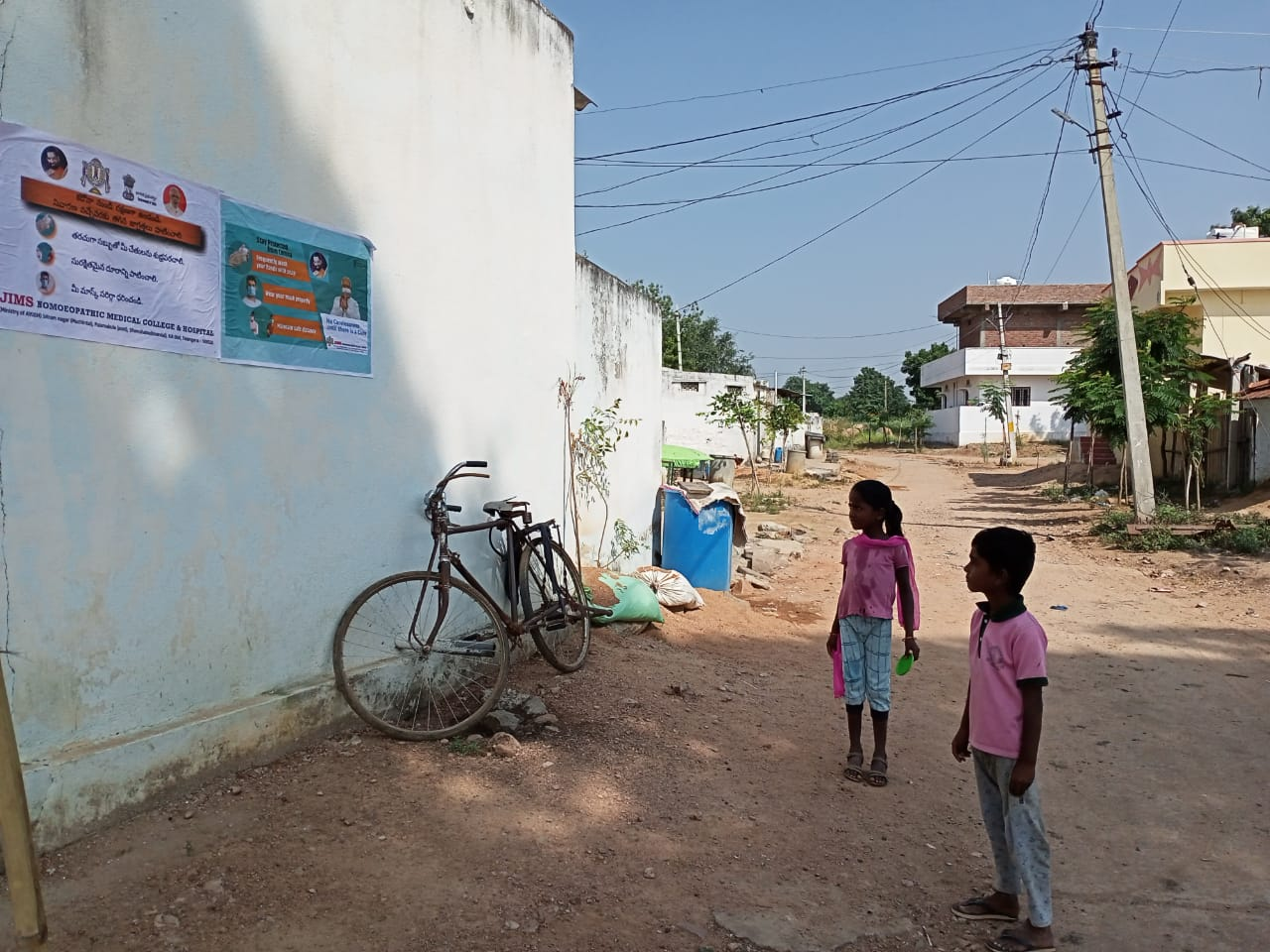 Janandolan campaign on COVID 19 – IEC Poster sticking at Manchan padu village. This is another hamlet village of Modallaguda panchayath